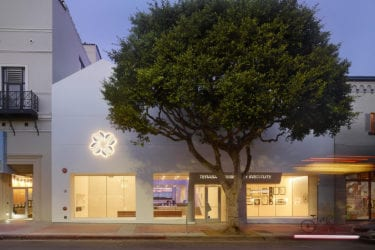 Beautifully lit white facade of the new Terasaki Research Institute, LA