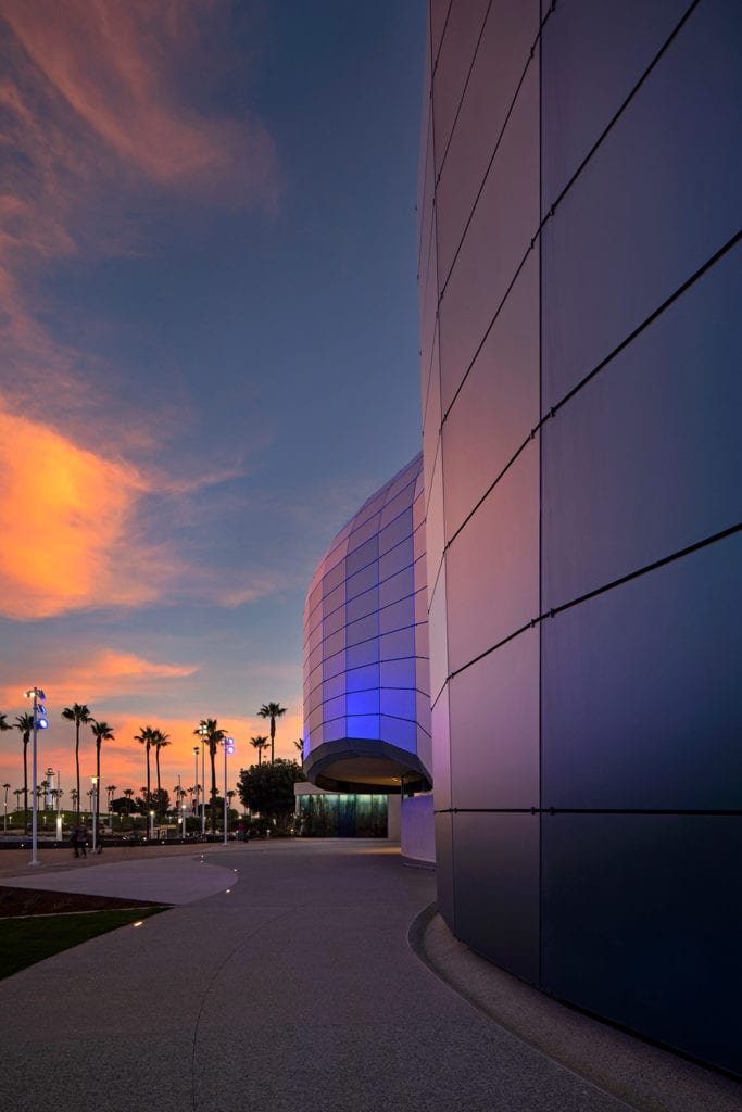 Portrait view at sunset of the complex glass facade of the Long Beach Aquarium, CA, USA