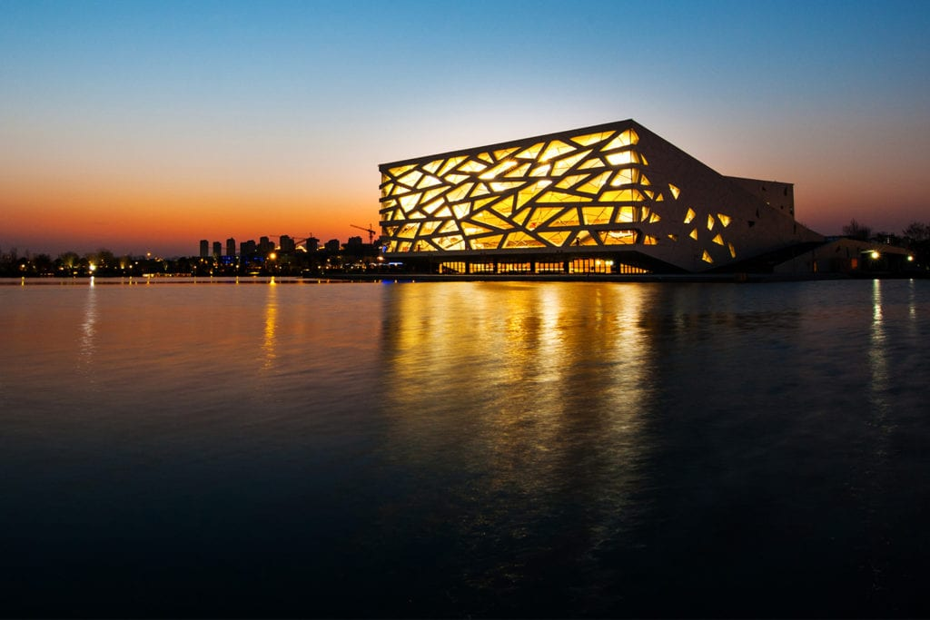 Sun setting on Yuhang Cultural Arts Centre and the lake