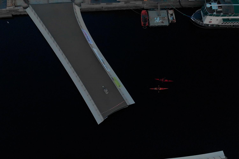 Aerial shot of Lille Langebro bridge against dark water
