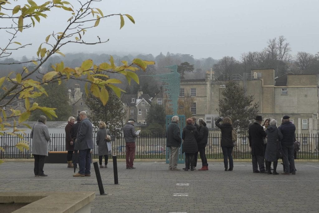 Maid of the Bridge sculpture being admired by onlookers in Bath
