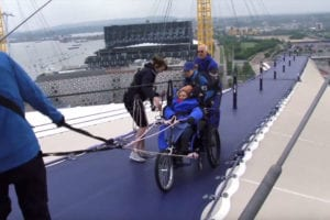 Person in wheelchair climbing the O2