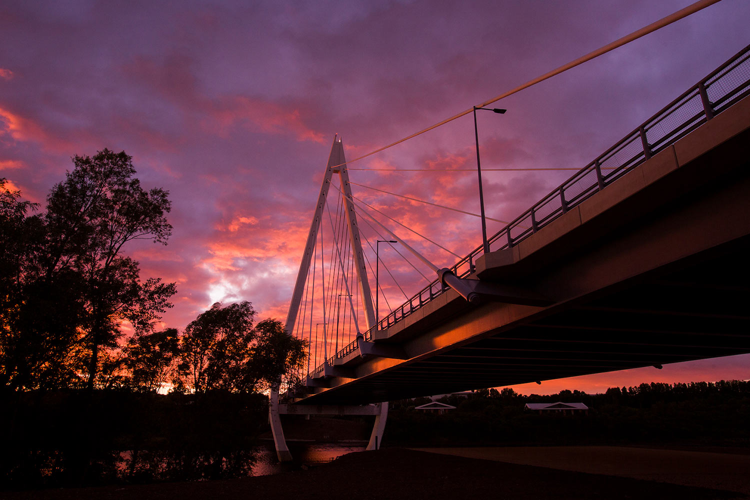 Northern Spire against a vibrant pink and red sunset