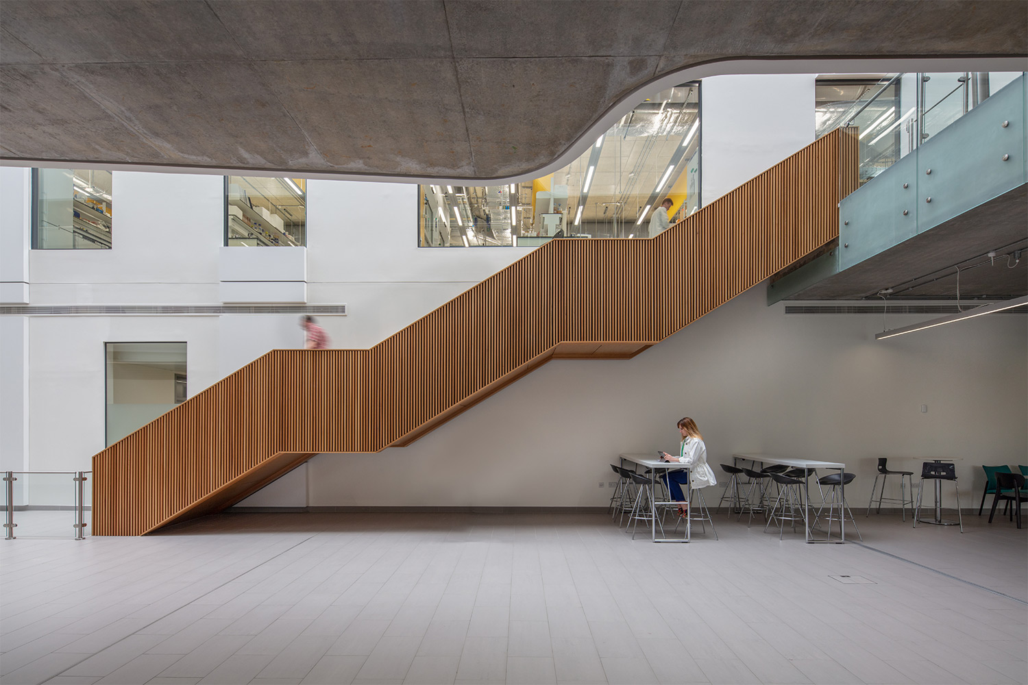a man descending a set of wooden stairs at the Quadram Institute