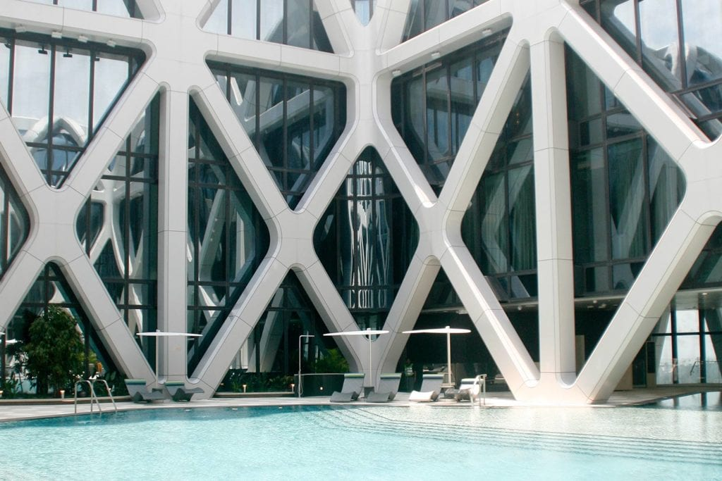 Morpheus' exoskeleton towering above the hotel's swimming pool