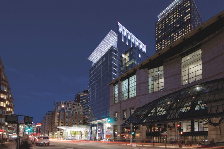 Exterior view of 888 Boylston, lit up at night