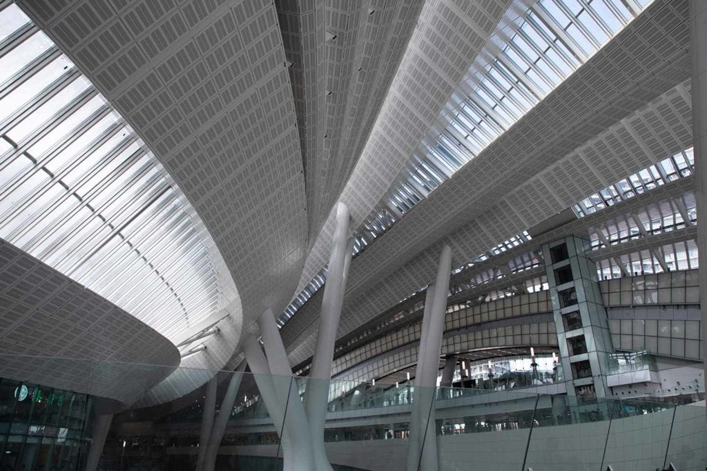 Natural light flooding space through sweeping roof of West Kowloon Terminus Station