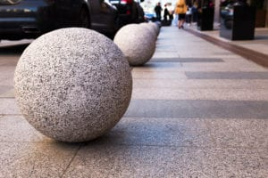 Spherical bollards lined up on pavement for urban security