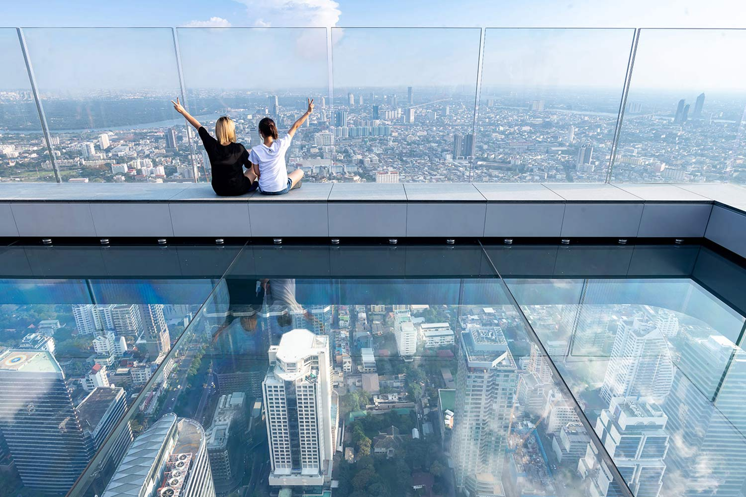 SkyWalkers sitting on SkyDeck at the top of MahaNakhon Tower