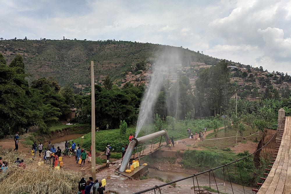 Pipe spraying water in the air next to Gatare Bridge