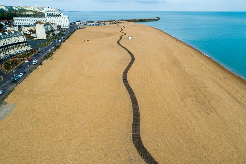 Snake-like wooden path winds down the length of Folkestone Harbour beach