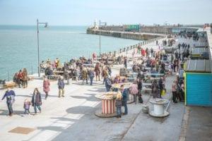 People gathering to enjoy Folkestone Harbour
