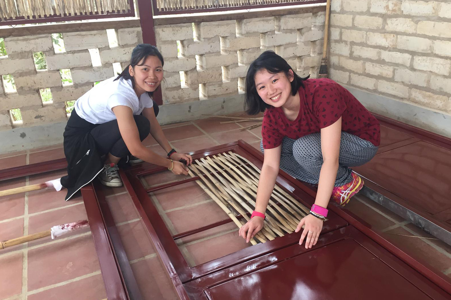 Agricultural students creating bamboo panels for ventilation in the school