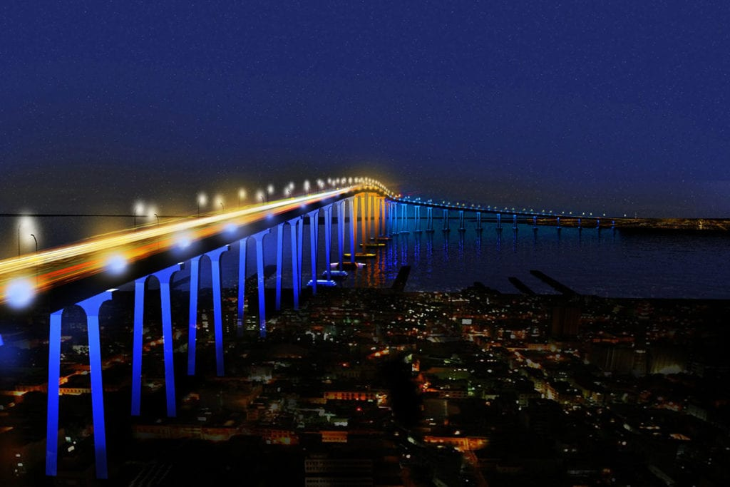 Nightscape of Coronado Bay Bridge, lit up against the dark sky in gold and blue