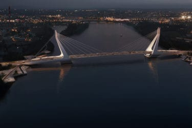 Nightscape of New Danube Bridge, its lights reflected in the water below