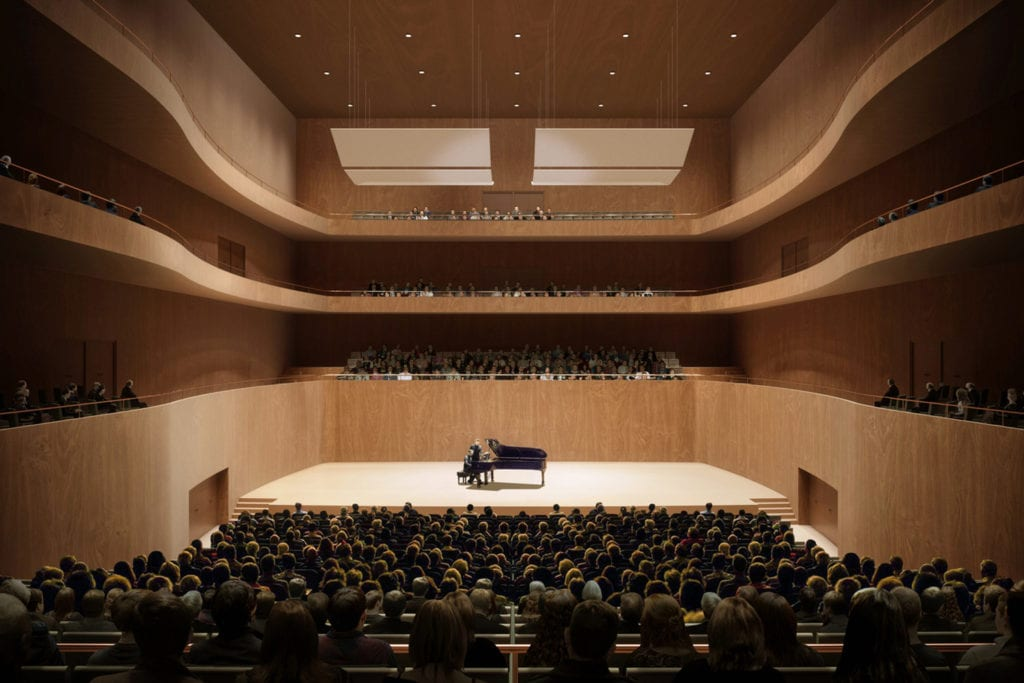 Interior view of Nurnberg Concert Hall, where a pianist is pictured playing on the stage