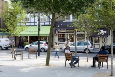 People relaxing in wooden chairs on South End High Street