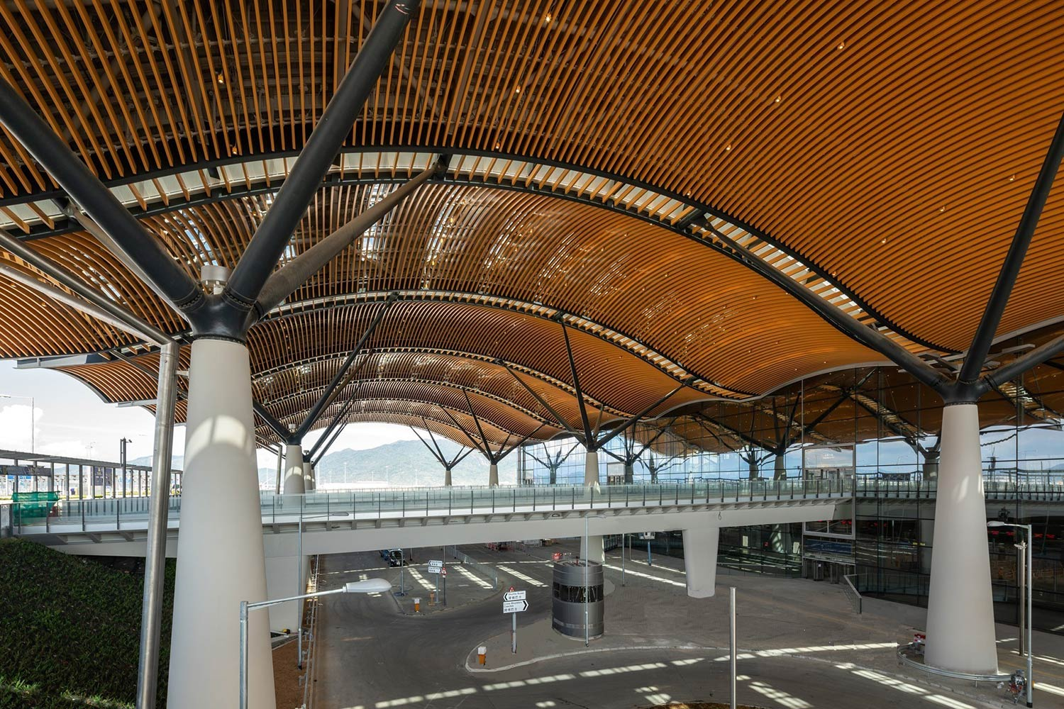 Tree-like structural columns hold up curved roof of the Hong Kong Port Passenger Clearance Building