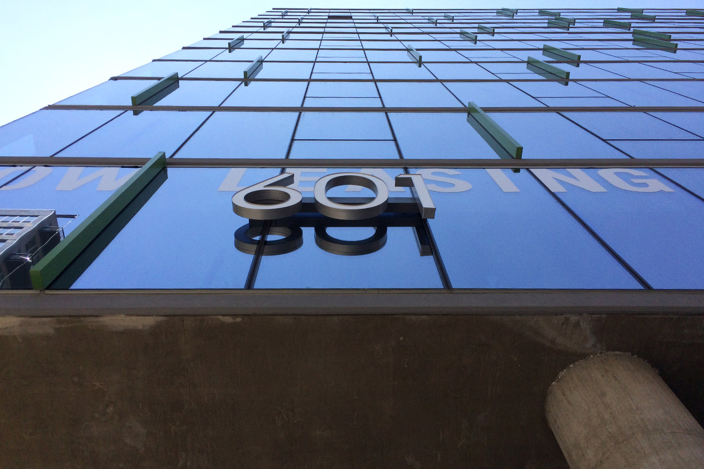 Close-up at street level of JeffJack Apartments' building and its number, 601