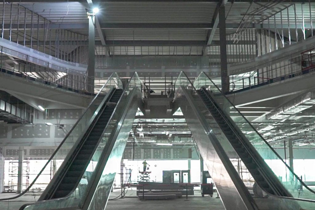 Interior view of escalators at Manchester Terminal 2