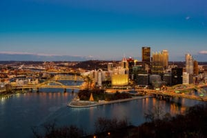 A wide view of the Pittsburgh skyline at sunset