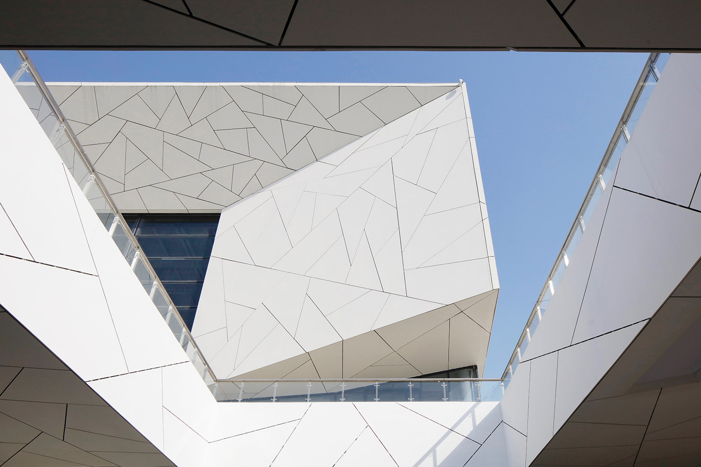 Close-up shot of the Yuhang Cultural Arts Centre's white angular facade