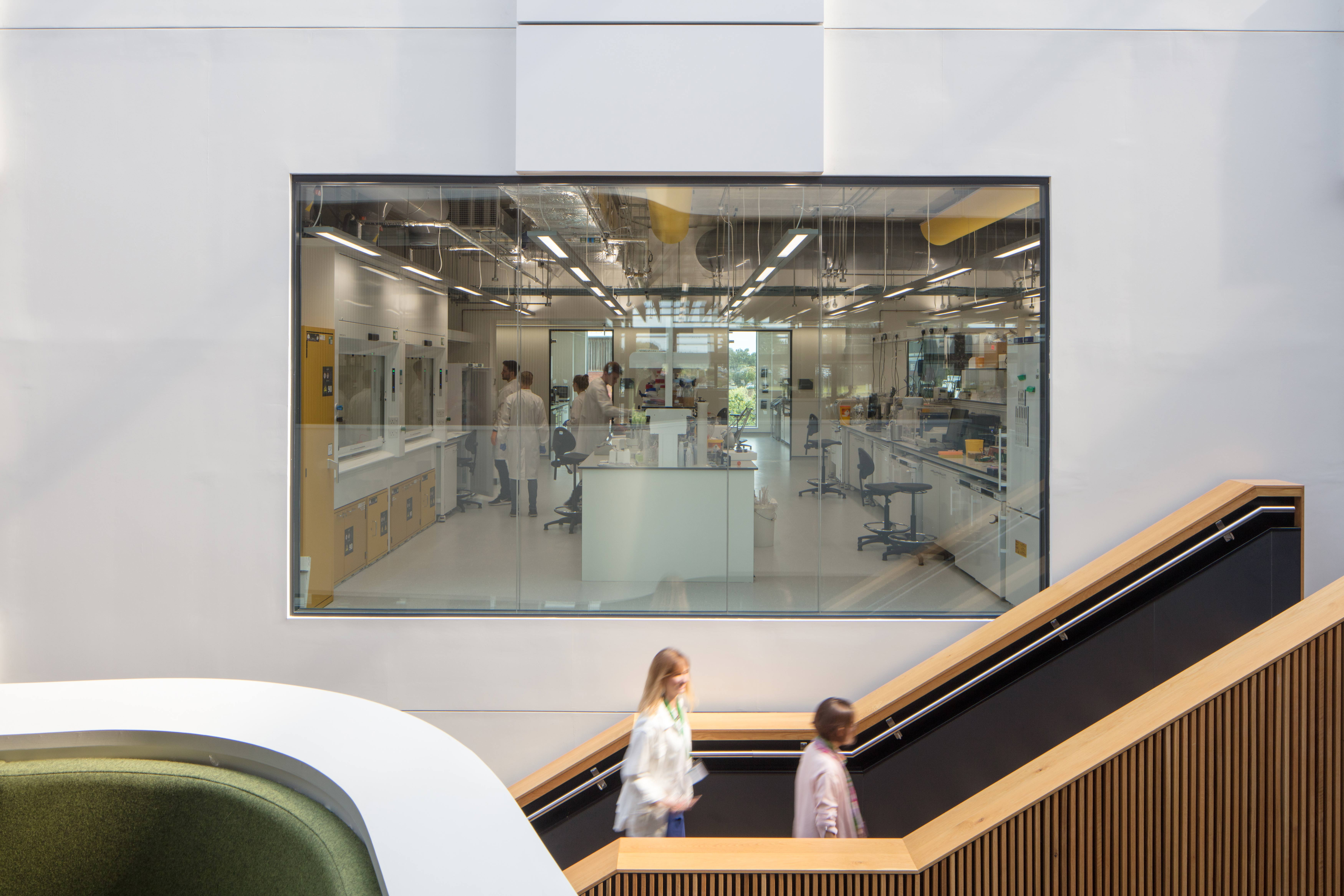 People ascending the stairs outside a research lab in the Quadram Institute