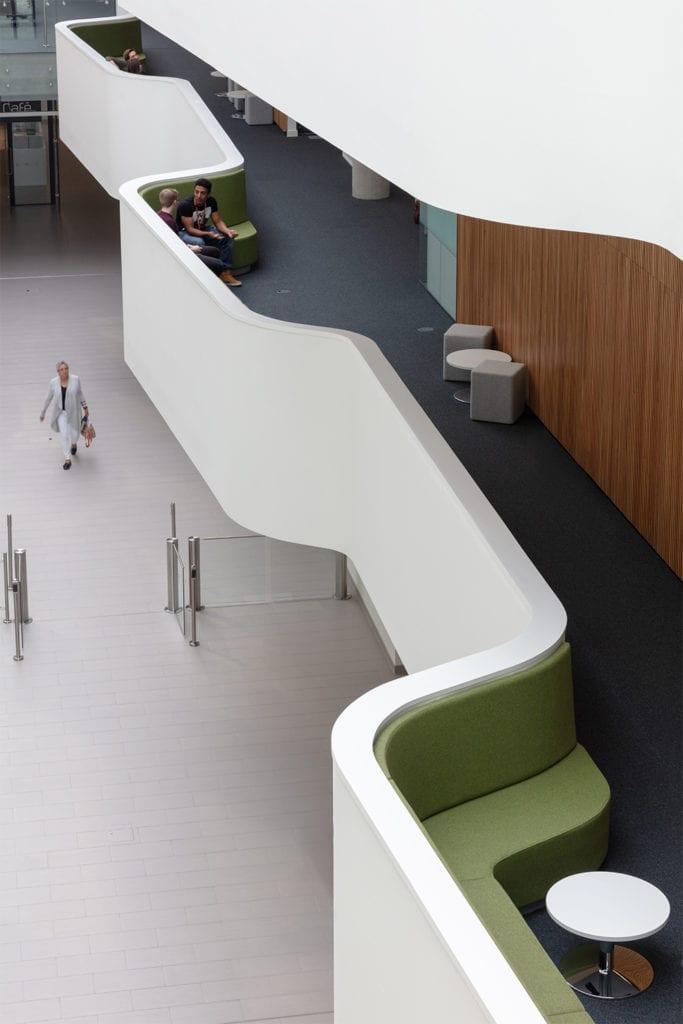 bird's eye view of man walking through a corridor at the Quadram Institute
