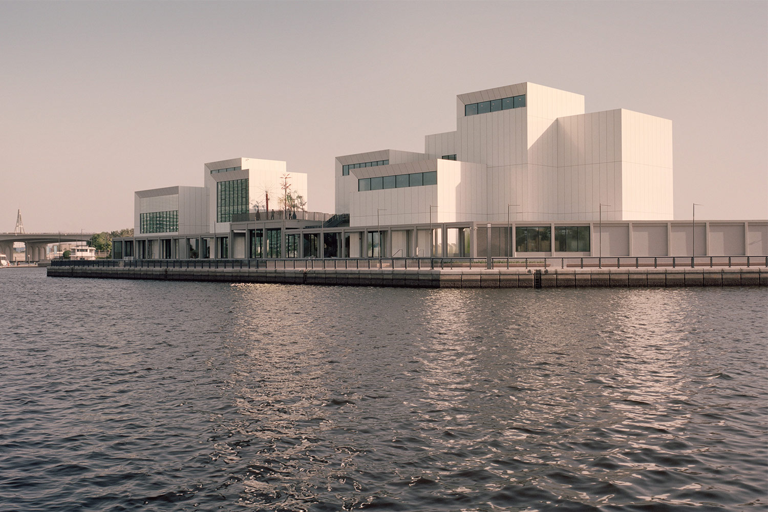 View of Jameel Arts Centre from the water beyond