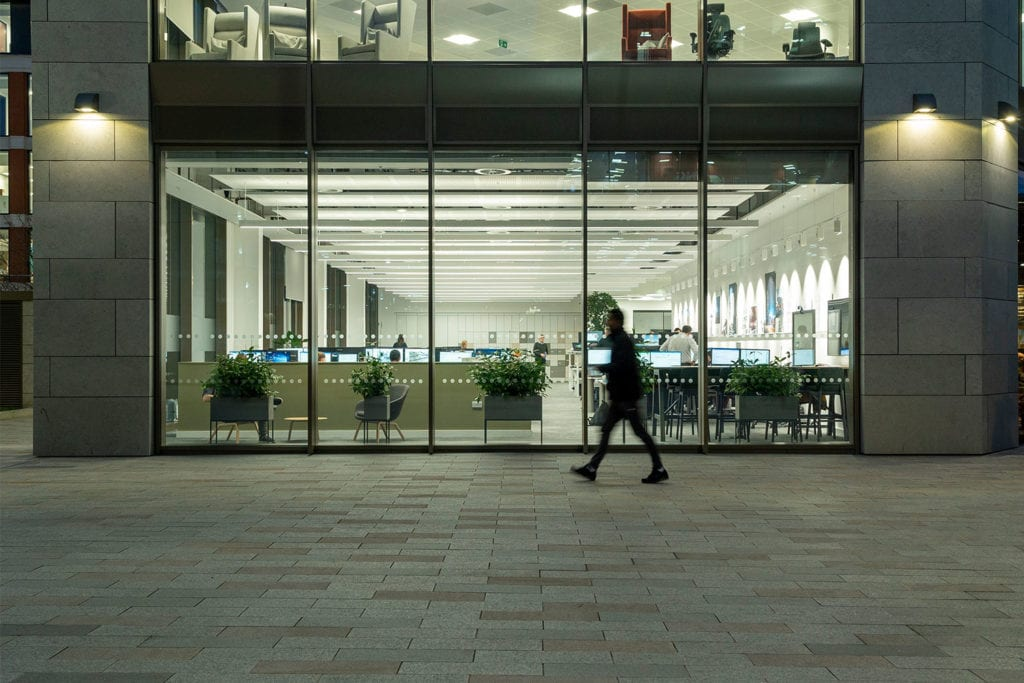 Person walking at night outside of Buro Happold Leeds Office