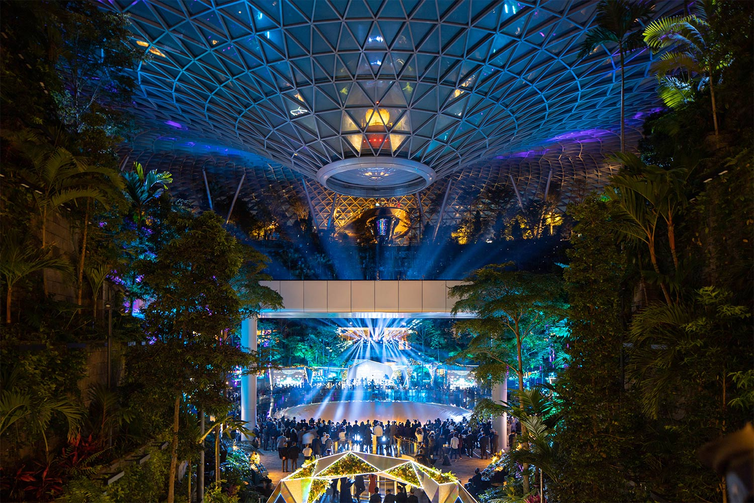 Colourful lighting scheme illuminating Jewel Changi Airport at night