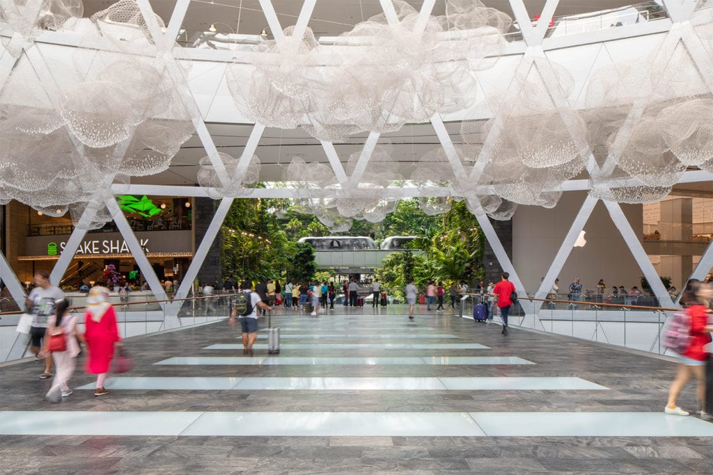 People traversing vast open space within Jewel Changi Airport