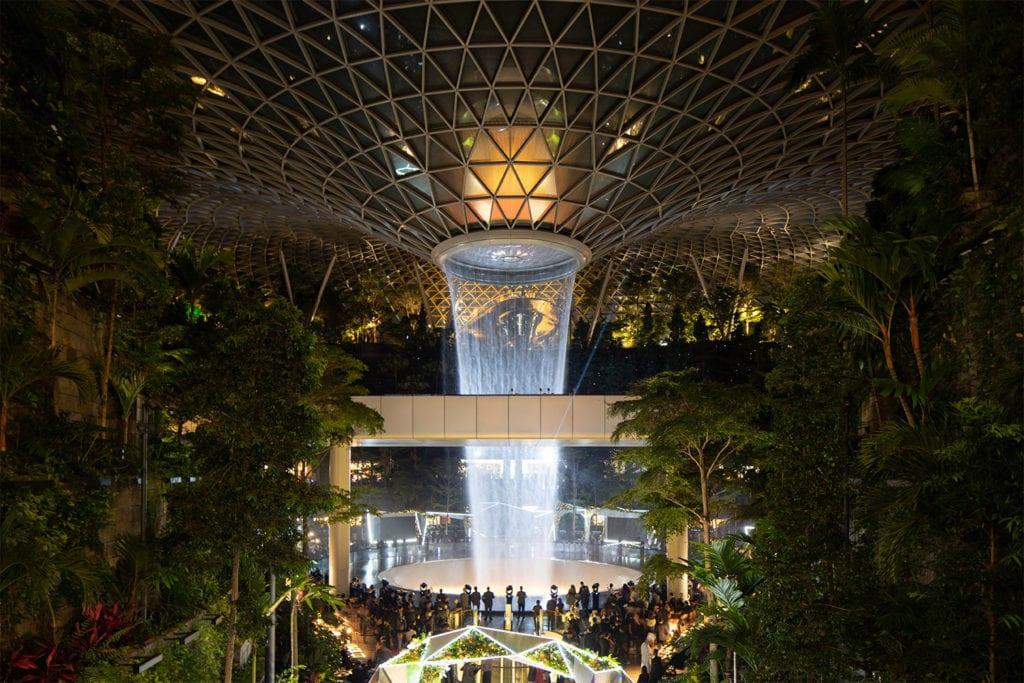 View at night of Jewel Changi Airport's Rain Vortex illuminated by lights
