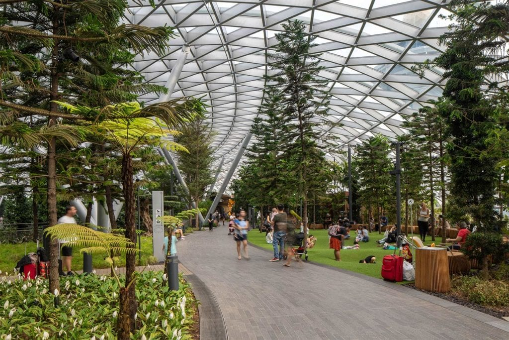 People walking through the lush gardens at Jewel Changi Airport