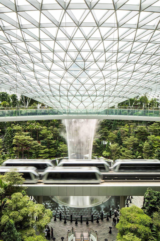 View of trains crossing Rain Vortex inside Jewel Changi Airport