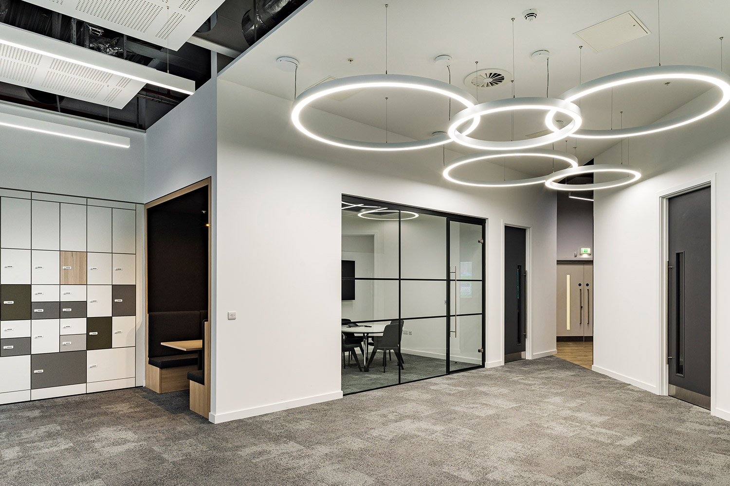 Internal photo of Buro Happold's Leeds office, including break out spaces, lockers and feature lighting