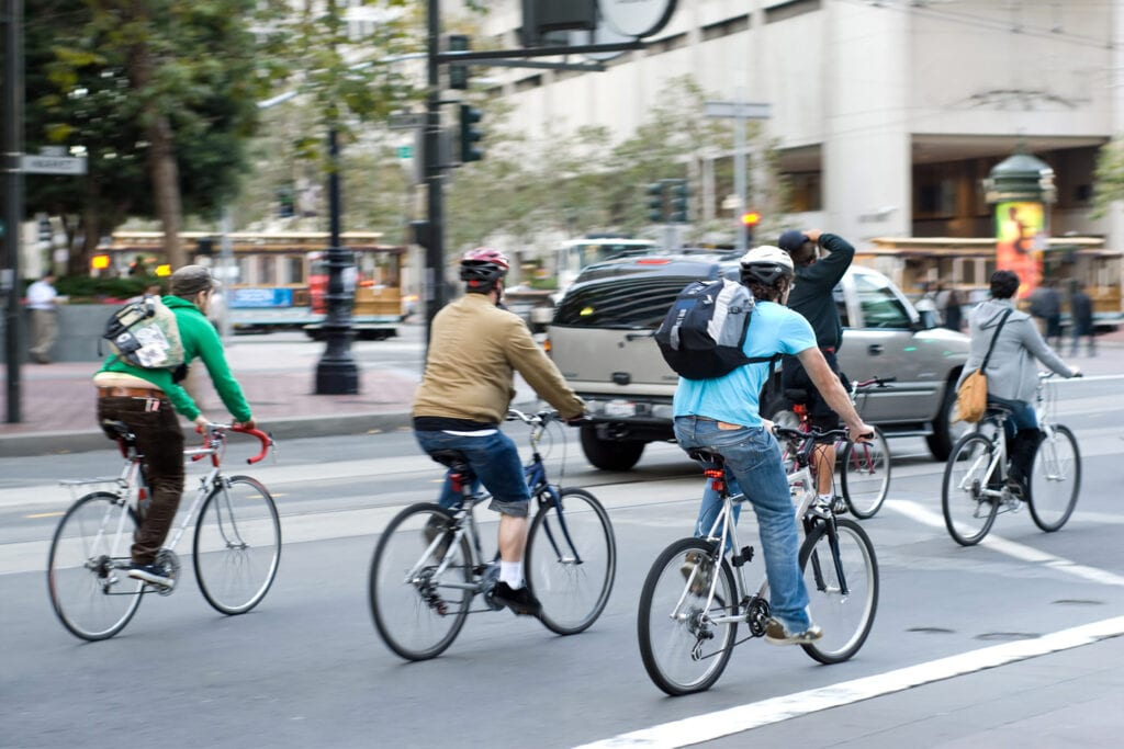 people cycling in an American city