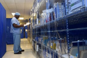 Medical worker in the surgical equipment supply room within the Sterile Processing Department